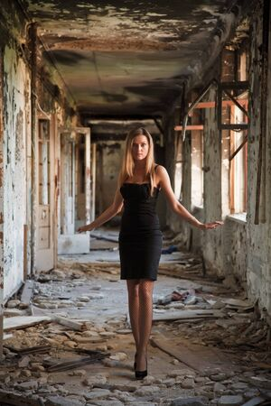 Woman in an abandoned building photo