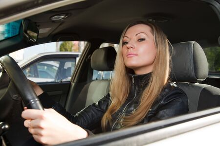 Pretty woman in a car. photo