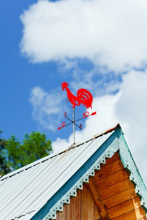 Weathercock on a roof photo