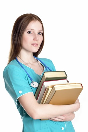 scientific literature: Portrait of serious female doctor in the green uniform with books.