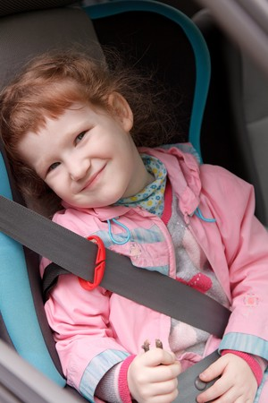 car seat: Cute little girl in a baby car seat Stock Photo