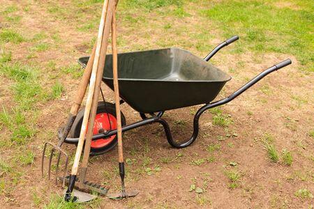 Wheelbarrow and gardening equipment Stock Photo - 7143061