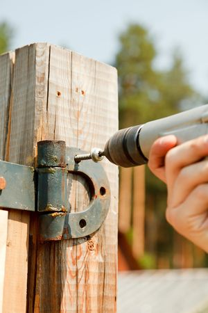 Contractors hands as he uses a drill to install screws Stock Photo - 7172680