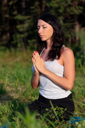 mind body spirit: young woman in yoga position, evening light