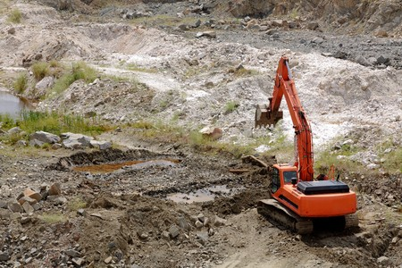 Excavator standing in sandpit with risen bucket Stock Photo - 7388948