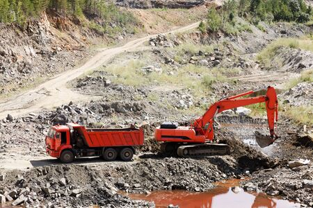 Dump Truck and Excavator in a Quarry  photo