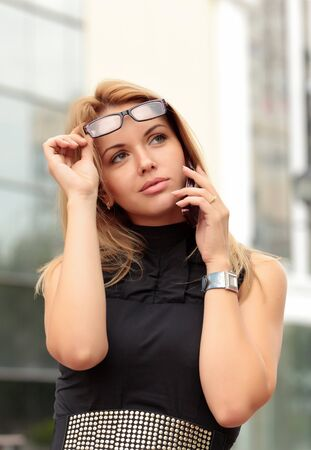 beautiful young businesswoman talking by mobile phone  photo