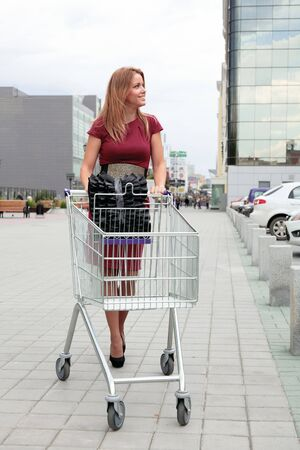 Woman with Shopping Cart ready to do some shopping. photo