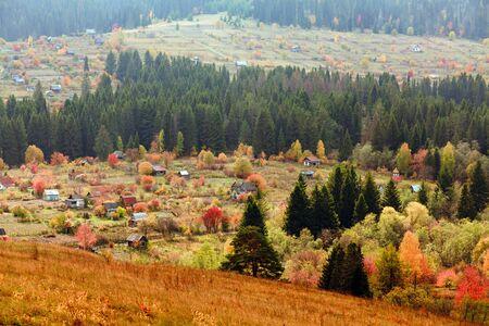 Beautiful autumn mountain and the village on mountainside  photo