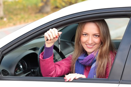 The happy woman showing the key of her new car. Stock Photo - 7904037