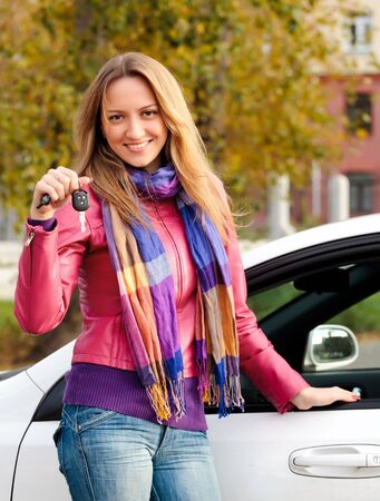 The happy woman showing the key of her new car Stock Photo - 7904045