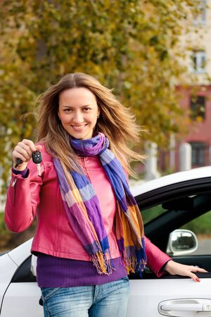 The happy woman showing the key of her new car Stock Photo - 7904046