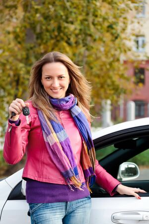 The happy woman showing the key of her new car. Stock Photo - 7904047
