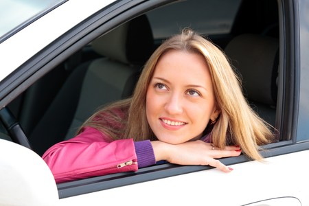 Woman Sitting In Car  photo