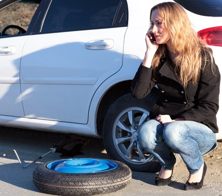 roadside assistance: Woman with damaged car calling for help. Stock Photo
