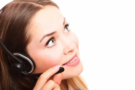 Pretty caucasian woman with headset smiling during a telephone conversation. Stock Photo - 8025796
