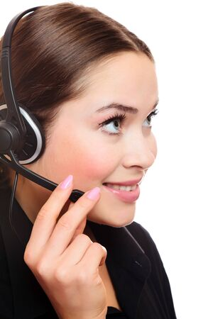 Pretty caucasian woman with headset smiling during a telephone conversation. Stock Photo - 8025802