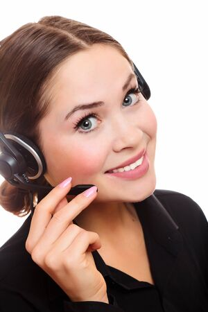 Pretty caucasian woman with headset smiling during a telephone conversation. Stock Photo - 8025801