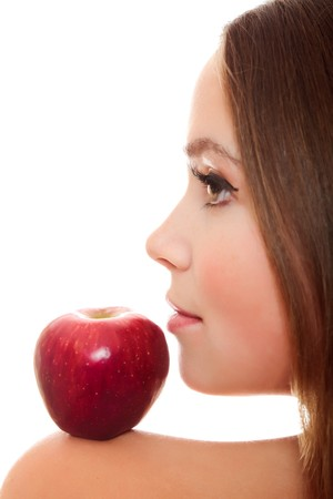 Pretty woman with red apple on her shoulder Stock Photo - 8048938
