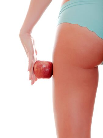 Perfect female figure and red apple photo