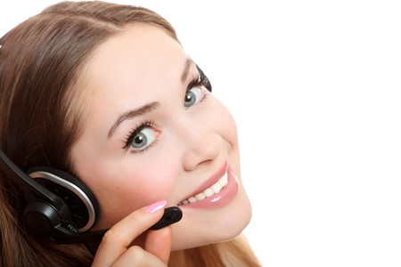 Pretty caucasian woman with headset smiling during a telephone conversation. photo