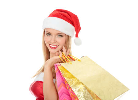 Pretty girl in a red hat with colorful bags isolated over white background. Stock Photo - 8256798