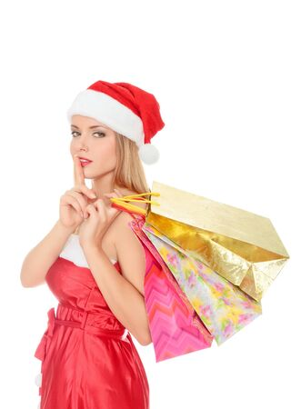 Pretty young woman dressed as Santa with shopping bags. Isolated over a white background photo