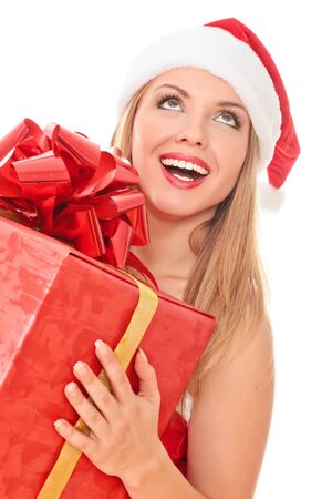 Cheerful santa helper girl with gift box. Isolated over a white background. Stock Photo - 8256810