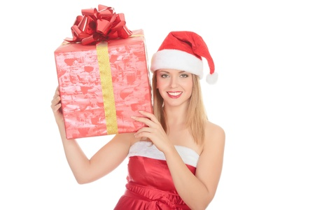 Cheerful santa helper girl with big gift box on her shoulder. Isolated over a white background. Stock Photo - 8256802