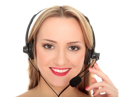 Pretty caucasian woman with headset smiling during a telephone conversation. Isolated over a white background. Stock Photo - 8256819