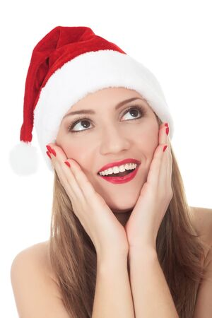Beautiful young woman in red wearing santa hat. Isolated on white background. Stock Photo - 8256820