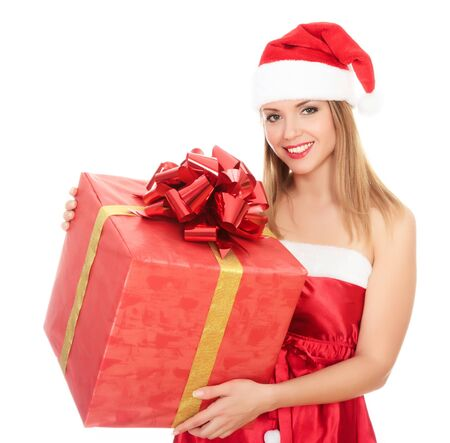 Cheerful santa helper girl with gift box. Isolated over a white background. Stock Photo - 8329456