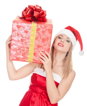 Cheerful santa helper girl with big gift box on her shoulder. Isolated over a white background. Stock Photo - 8329462