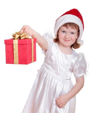 Baby girl in Santas hat holding her Christmas present isolated on white photo