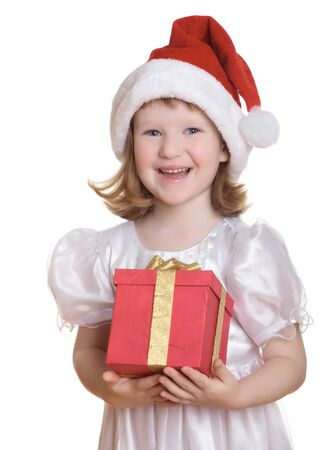 Baby girl in Santas hat holding her Christmas present, isolated on white background. photo