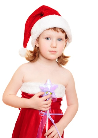 Little fairy wearing santas hat and red dress holding magic wand photo