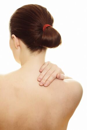 Woman massaging pain back isolated over a white background. Stock Photo - 8418688