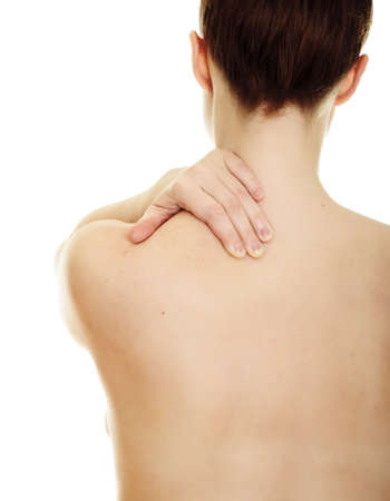 Woman massaging pain back isolated over a white background Stock Photo - 8418679