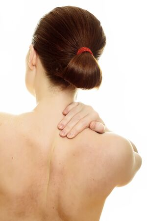 Woman from behind, naked body, holding her neck on the right side photo