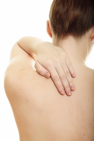 Woman from behind, naked body, holds her neck on the left side. Isolated over a white background.  photo