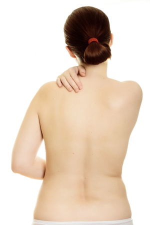 Woman massaging pain back isolated over a white background.