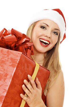 Cheerful santa helper girl with big gift box. Isolated over a white background photo