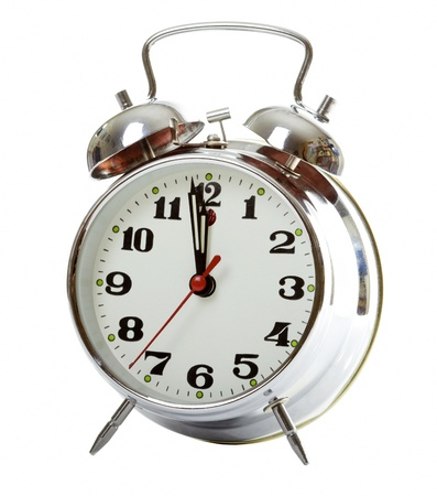 clang: Alarm clock. Old-fashioned style silver alarm clock, isolated over a white background. Stock Photo