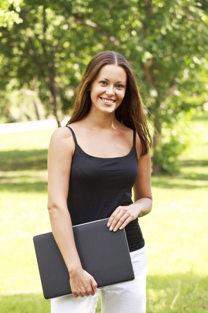 Young pretty woman with laptop at park Stock Photo - 8710047