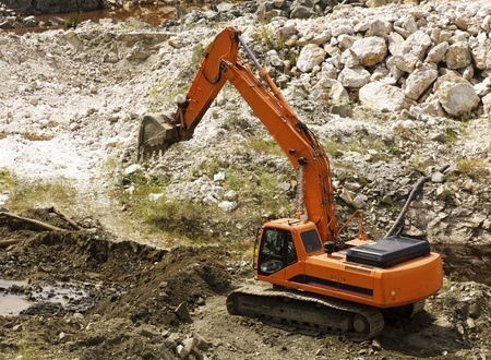 excavator during earthmoving works outdoors at construction site photo