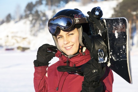The young adult female snowboarder photo