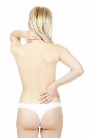 shoulder problem: Woman massaging pain back, isolated on white background Stock Photo