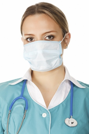 surgeon mask: Portrait of female doctor in mask with stethoscope. isolated on white background