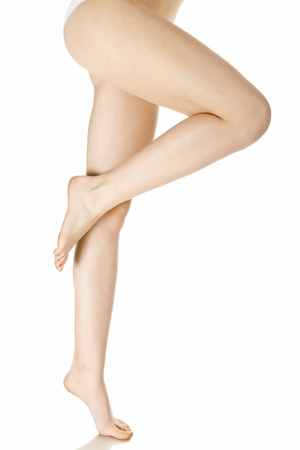 is slender: Slender and long beautiful female legs, isolated on white background
