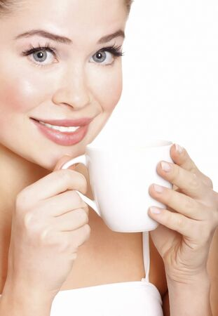 young attractive woman with cup on white background Stock Photo - 9032440